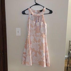 a pink and white floral dress